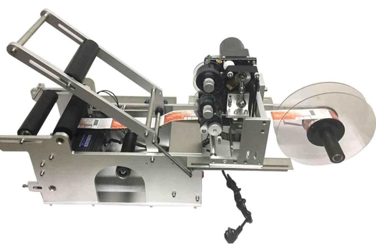 YXT1530半自动动圆瓶贴标机(加打码机)